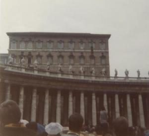 Pope John Paul speaks from tapestry-clad Papal balcony. ( top floor, second window, right)