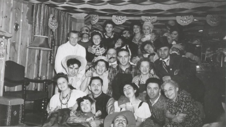 Harry Levene is front row wearing a top hat. In the centre, the man with the fake beard, is actor Lou Jacobi. He was a hired actor for that event. The Toronto born actor would find fame on the Broadway stage on in many Hollywood studio films. Anne Levene stands to his right.