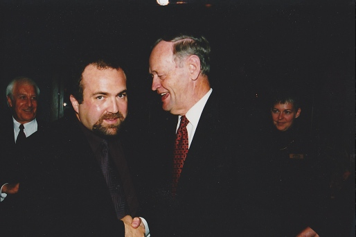 Shaking the hand of Canadian Prime Minister Jean Chretien at an event.